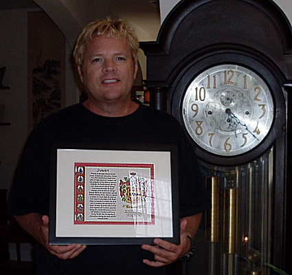 Freddy Stewart with his Birthday Gift of a Framed Stewart Family Crest Print